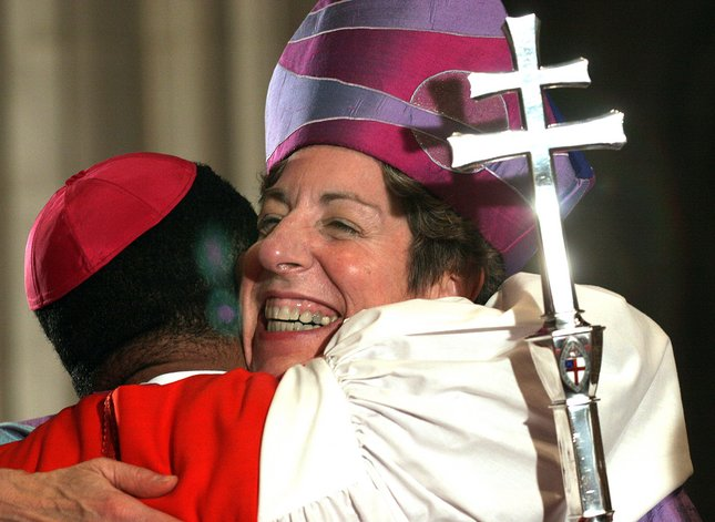 Rev. Katharine Jefferts Schori hugs a wellwisher after she was installed as the 26th Presiding Bishop of the Episcopal Church at the National Cathedral in Washington, DC, 04 November 2006. Schori, the first woman primate in the Anglican communion, replaces Bishop Frank Griswold.    AFP PHOTO/Nicholas KAMM  (Photo credit should read NICHOLAS KAMM/AFP/Getty Images)
